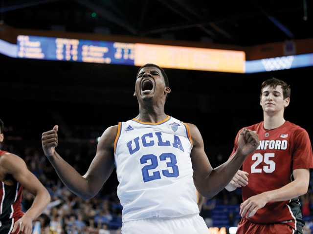 UCLA forward Tony Parker, middle, celebrates after scoring as Stanford guard Anthony Brown, left, and forward Rosco Allen watch on Thursday in Los Angeles.