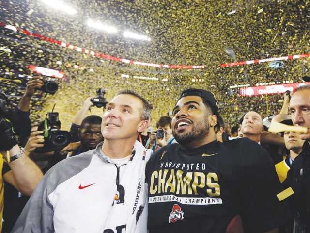 Ohio State head coach Urban Meyer and quarterback Cardale Jones celebrate after the college football playoff championship game on Monday in Arlington, Texas.
