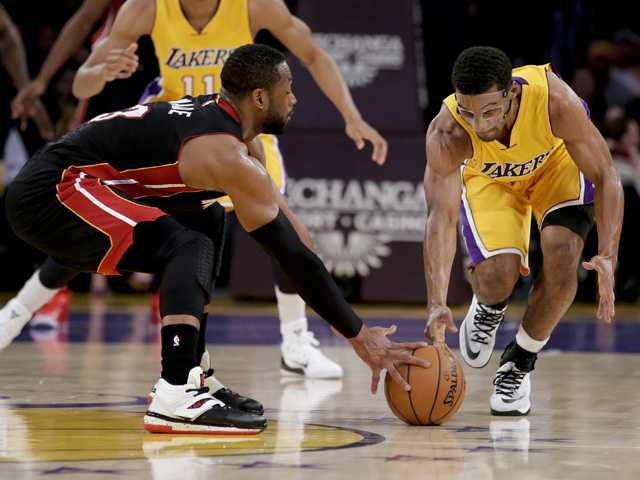 Heat hold of Kobe, Lakers