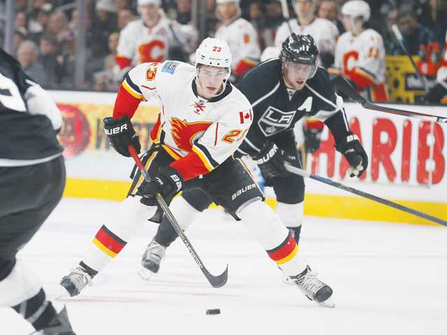Flames rally past Kings with goal in overtime