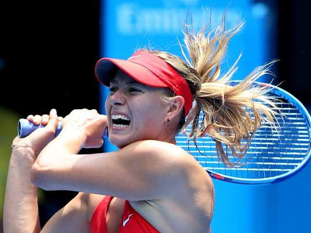 Sharapova survives, advances at Australian Open