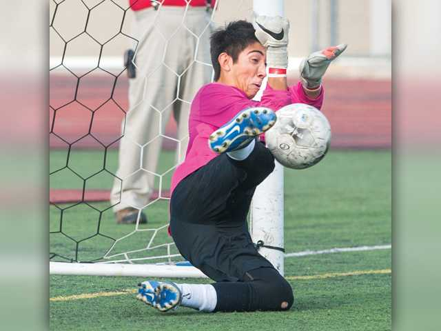 Hart boys soccer survives scare in round one