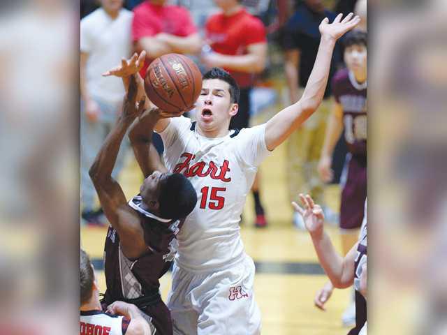 Hart boys basketball makes move late