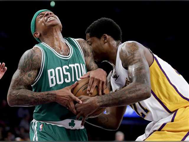 Lakers stop 7-game losing streak with OT win over Celtics