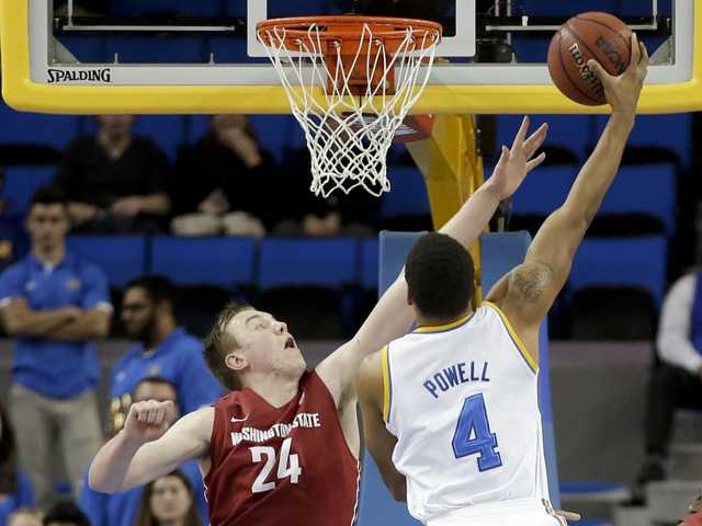 UCLA guard Norman Powell, right, shoots over Washington State forward Josh Hawkinson on Sunday in Los Angeles.