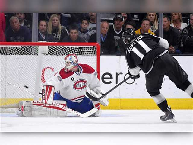 Kings rally late, top Montreal