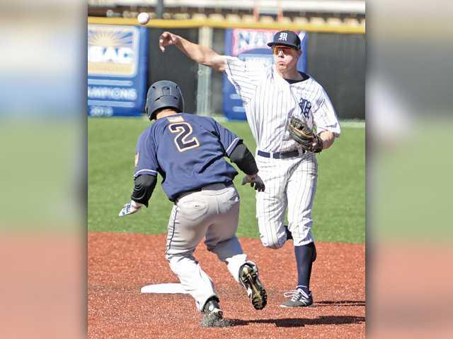 Master's baseball earns doubleheader split