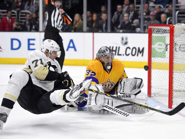 Kings fall to Penguins in OT