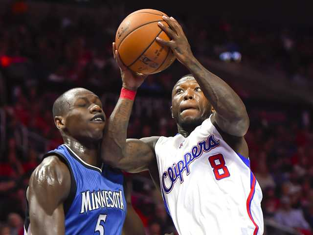 Redick leads short-handed Clippers past Minnesota