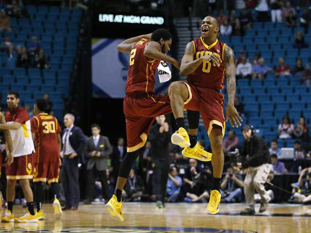 USC's Malik Martin, left, and Darion Clark celebrate during their game against Arizona State in the first round of the Pac-12 Tournament on Wednesday in Las Vegas.