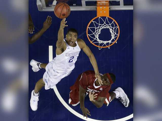 Kentucky guard Aaron Harrison (2) shoots against Arkansas forward Bobby Portis (10) during the second half of the Southeastern Conference tournament championship game, Sunday in Nashville, Tenn.