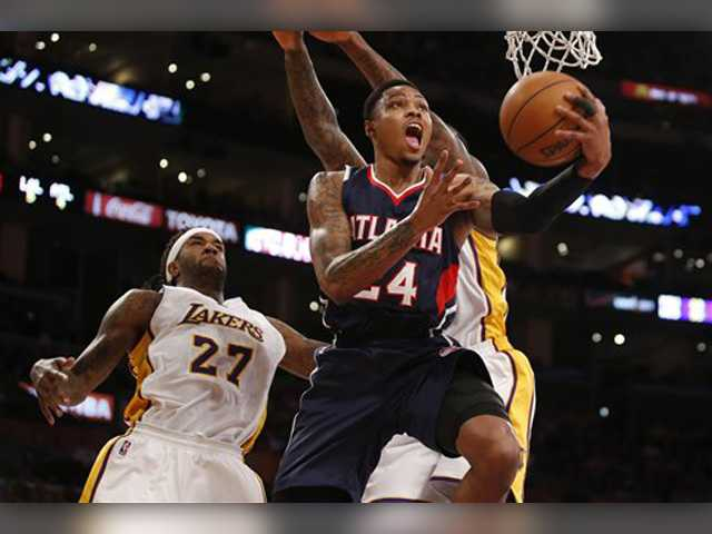 Lakers hang with Hawks but fall late