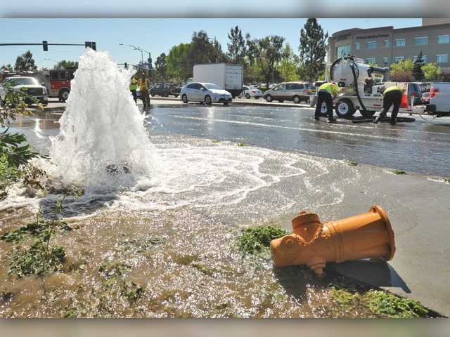 Sheared-off fire hydrant powers some 50,000 gallons down drain