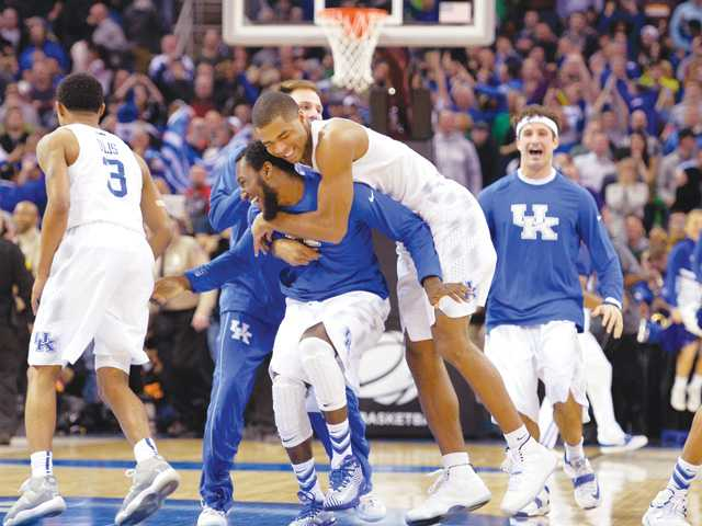 Kentucky players celebrate after a 68-66 win over Notre Dame in the Elite Eight on Saturday in Cleveland.