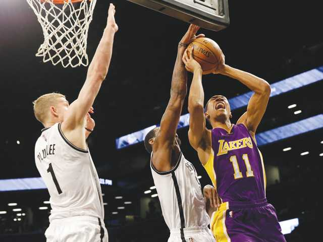 Shorthanded Lakers go down to Nets