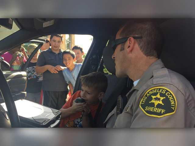 Kids leap into action as sheriff's officials demonstrate the job
