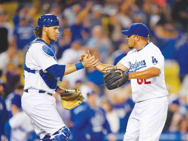 Greinke, Dodgers beat Rockies