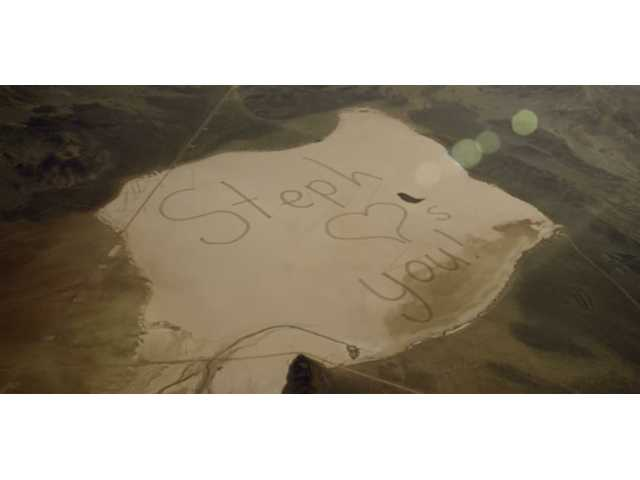 Daughter writes her father a letter he can see from space