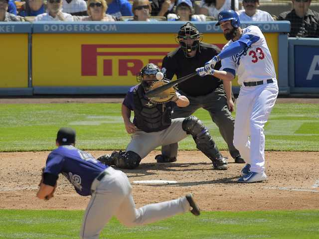 Dodgers use long ball to sweep Rockies