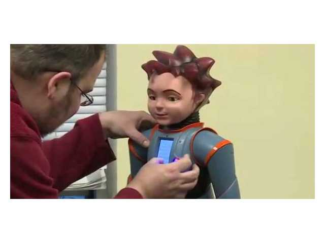 Robot Milo helps children with autism learn social skills