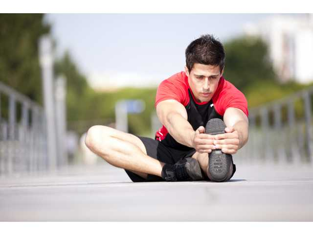 How to prevent sports injuries through warm-ups and proper stretching