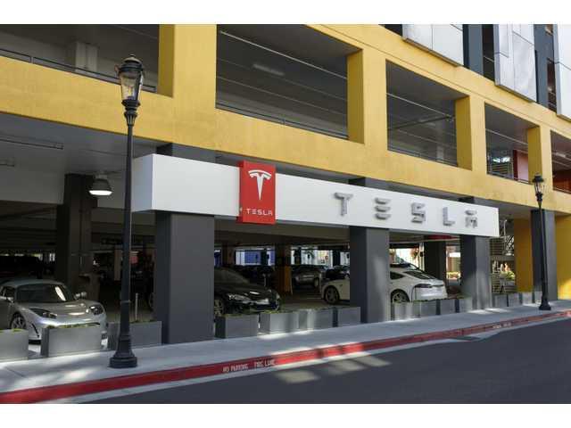 Google jumps into car business, came close to buying Tesla