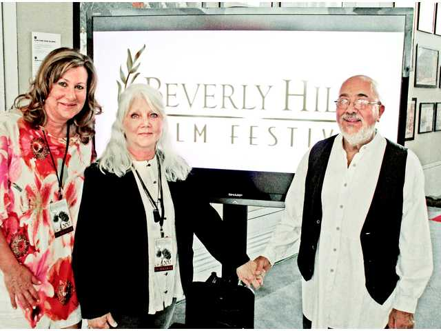 """The 13th Step"" producer Monica Richardson, left, with Karla Brada's mother and father Jaroslava and Hector Mendez at the Beverly Hills Film Festival where the film won best documentary."