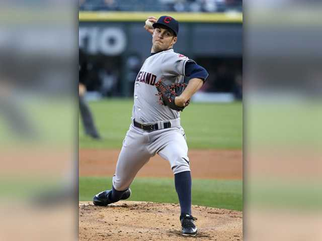 Hart grad stops Chicago streak, pitches Indians to win