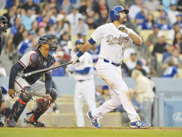 Dodgers hit 3 HRs in 8th to beat Braves