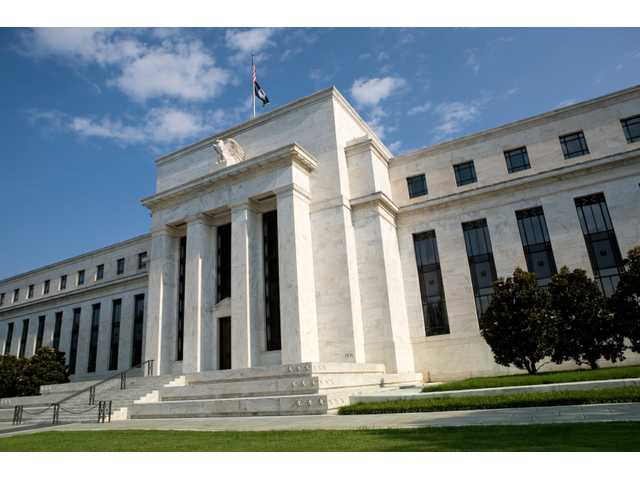 Fed holding off on rate increases but says it could still happen this year