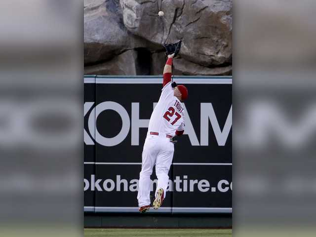 Mike Trout powers Angels past Yankees with bat and glove