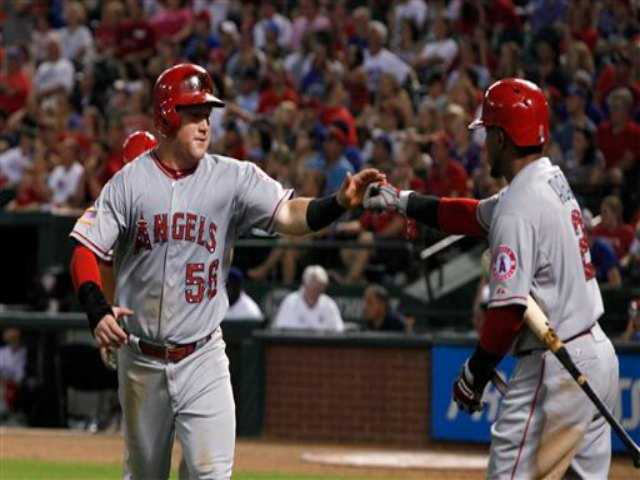 Santiago goes 7 innings in Angels' 13-0 win at Texas