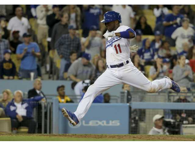 Rollins rallies Dodgers past his old Phillies team
