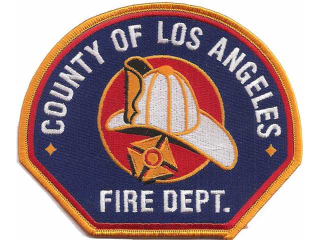 Threat of brush fire snuffed out by Los Angeles County Firefighters at Sunday morning car fire near Sand Canyon.