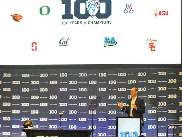 Pac-12 Commissioner Larry Scott addresses the media on Thursday at the first day of Pac-12 Media Days at Warner Bros. Studios in Burbank. Signal photo by Katharine Lotze.