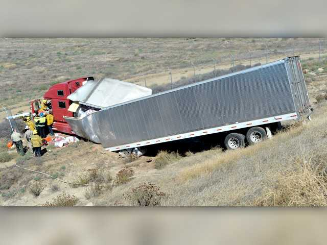 Big rig crashes at Castaic roundabout