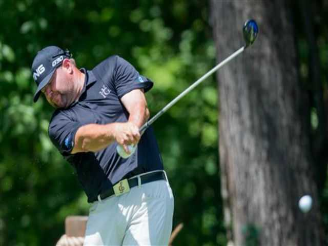 Hart grad Gore leads, Woods in second at Wyndham Championship