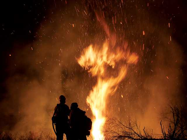 Photographer has up close view of raging wildfire