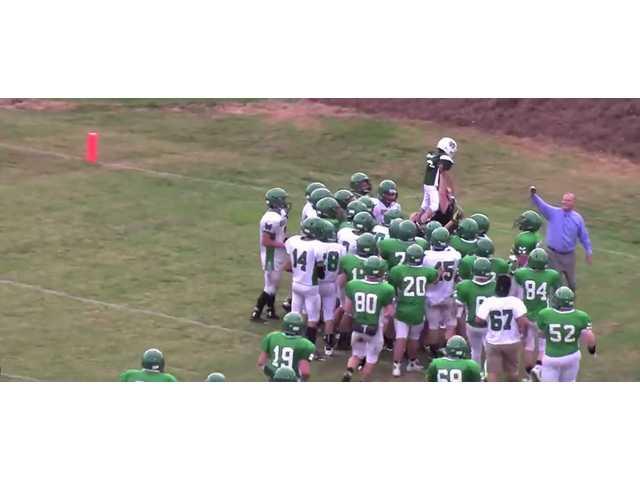 Boy battling brain cancer defies odds, scores touchdown