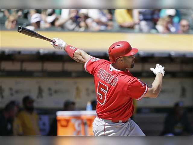 Pujols hits 35th home run as Angels take series from A's
