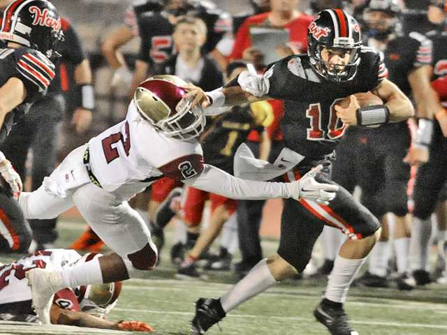 Hart football's Nick Moore leads the way in win over Downey