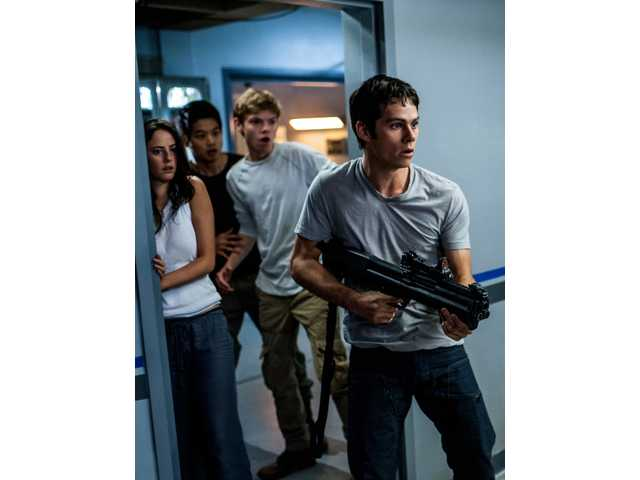 "Thomas (Dylan O'Brien, right) leads Teresa (Kaya Scodelario), Minho (Ki Hong Lee), and Newt (Thomas Brodie-Sangster) in a daring escape from WCKD in ""Maze Runner: The Scorch Trials."""