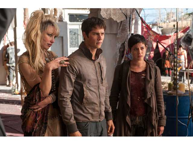 "Thomas (Dylan O'Brien, center) surveys his new environment, along with Ponytail (Jenny Gabrielle) and Brenda (Rosa Salazar) in ""Maze Runner: The Scorch Trials."""