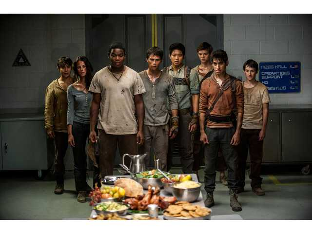 "The surviving Gladers react to something they hadn't seen in a long time: a feast… courtesy of WCKD. Glader (Gary Hood), left, Teresa (Kaya Scodelario), Frypan (Dexter Darden), Thomas (Dylan O'Brien), Minho (Ki Hong Lee), Newt (Thomas Brodie-Sangster), Winston (Alexander Flores) and Jack (Bryce Romero) in ""Maze Runner: The Scorch Trials."""