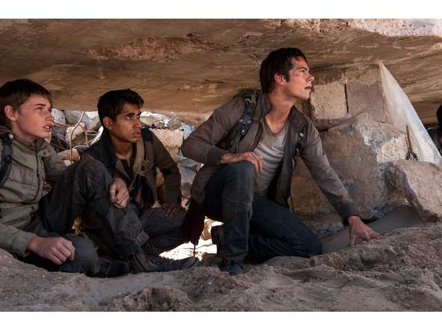 "Aris (Jacob Lofland), left, Winston (Alex Flores) and Thomas (Dylan O'Brien) make their way through the Scorch in ""Maze Runner: The Scorch Trials."""