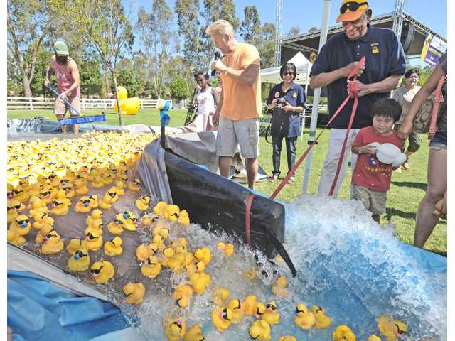 Residents flock to 13th Annual Rubber Ducky Festival in Valencia