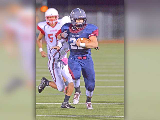 Trinity football runs away early in rout