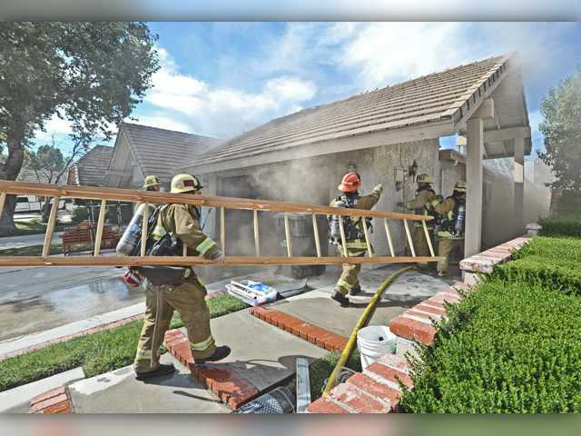 Fire destroys garage attic of Saugus home, but homeowner, dog unharmed