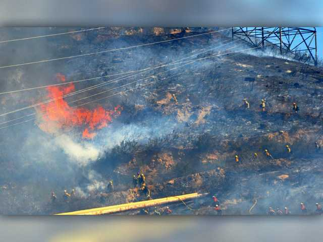 UPDATE: Brush fire fully contained after burning 15 acres