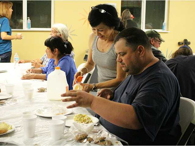 Churches help host nightly meals program at homeless shelter